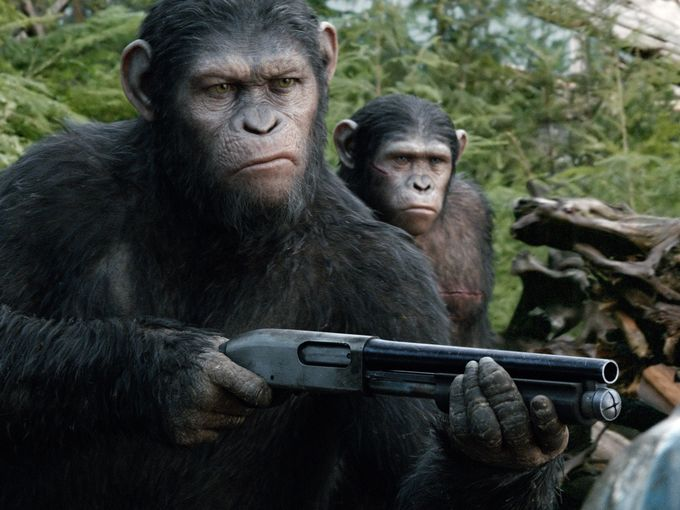 Dawn-of-the-Planet-of-the-Apes-Caesar-with-shotgun
