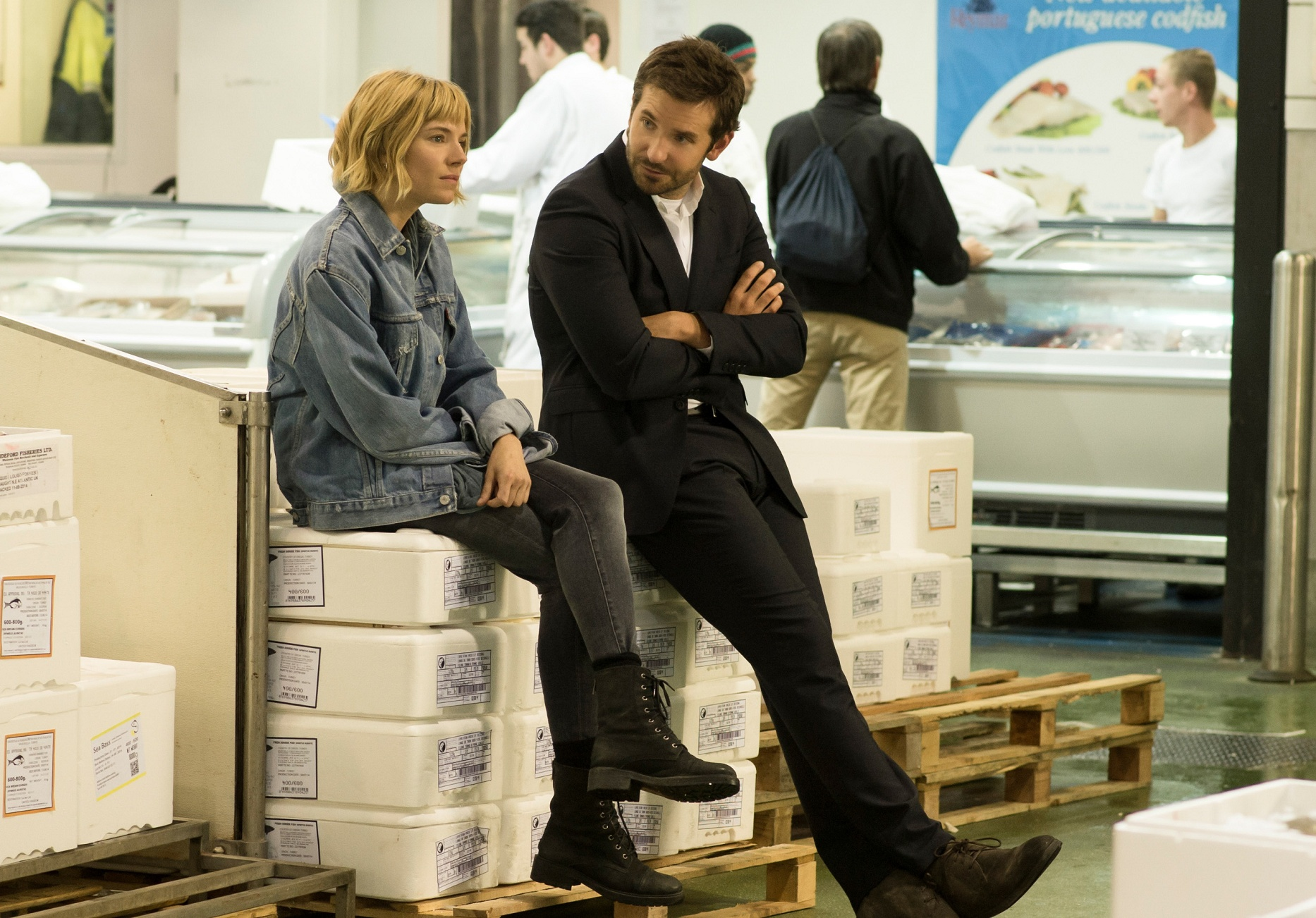 (L-R) SIENNA MILLER and BRADLEY COOPER star in BURNT